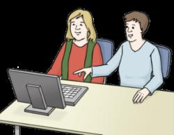 Mann und Frau sitzen am Tisch vor einem Computer
